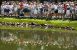 Hundreds of fans line the 18th hole to catch a glemps of 15-year-old golf phenome, Michelle Wie,...