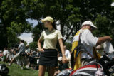 On the 6th hole Michelle Wie waits along with her caddie to move to the 5th.  At Cherry Hills...