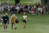 On the 9th hole Michell Wie maker her way up to the 9th green with Tom Landeen, (Lincicome's...