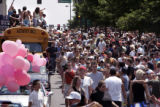 A bus load of students from Eaglerock School in Estes Park, is the last vehicle in the parade  at...