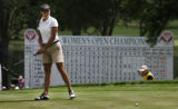 Amateur golfer Brittany Lang, of McKinney, Texas, closes her eyes as her put for par misses the...