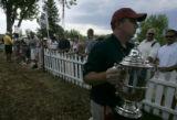 Shannon Doody (cq), of the USGA, carries the U.S. Women's Open Champioship Cup after Birdie Kim...