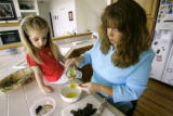 Heather Carroll (cq) of Colorado Springs cooks a Greek pasta dish with her daughter Molly (cq), 3,...