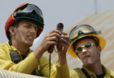 Wildland Firefighters from the Carbondale Fire Protection district (L-R) Richard Cornelius (cq)...