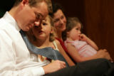 The newly appointed superintendent of  Denver Public Schools Michael Bennet leans down to listen...