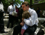 Michael Bennet hugs his daughter, Halina Bennet, 4, at a press conference after he is announced as...