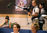 Stacey Wells (cq),23,right, of Littleton, Colo., looks over her class notes as Reality TV director...