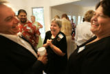 Joni Scotter, cq, center, volunteer coordinator for the Republican party of Iowa, laughs with Rep....