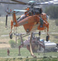 An Erickson Air-Crane takes off to fight the Mason Gulch Fire using a slurry load to dose flames...