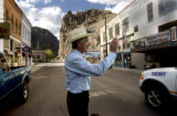 Creede, Colo. 5/27/04-- On the main avenue of Creede Attorney General Ken Salazar waves to the...