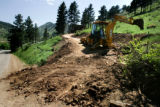 HGTV Dream House.  General Contractor James Casanova uses a backhoe to adjust the slope of the...