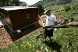 HGTV DREAM HOUSE.  Christopher Herr (cq), left, puts rocks over a weed barrier on a 3-foot...
