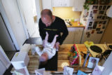HGTV DREAM HOUSE. Christopher Herr (cq) changes his daughter Talia's diaper in their condominium...