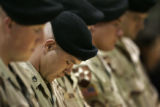 SSG Jeffery Abernathy, Charlie Company, 1-503rd Infantry Regiment, prays with the other men...