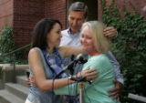 Becky Zimmerman (cq), left, hugs Dan Kubiak (cq), center, and Renee Kubiak (cq), right, at a press...