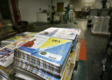 A pallet of Dex telephone books lays in wait to be bound at Quebecor World in Loveland where the...