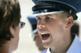 Cadet 2nd Class Albert Bond (cq), right, gives orders to a newly arrived freshman cadet at the Air...