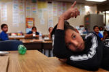 (Denver, Colo., June 2, 2004) Raul Duarte Loya, 11, of denver, raises his hand to answer a...