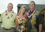 (Denver, Colo., June 23, 2005) Scott Schoelzel (with Janus Fund) with Karen and Mike (corporate...