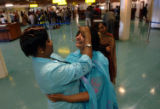 (NYT46) NAIROBI, Kenya -- June 29, 2005 -- NAIROBI-AIRPORT-2 -- Rashmita Shah, center, reacts...