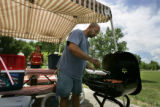 Top priority for a holiday camping trip is to get the dog cooking.  Phillip Quintana, (r) of...