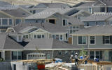 A D. R. Horton construction crew works on a home on E. Whitaker Cir. at the edge of the Tollgate...