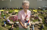 Betty Nelson (CQ), (location not to be identified), holds one of the gnomes she bought to replace...