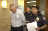 Harry Krausman is led out of Denver District court on Monday July 18,2005. Krausman, who stole...