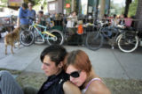 Andy Greschler, cq, left, Boulder, and Helen Carpenter, cq, Boulder, sit on the lawn outside Penny...