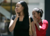 Shellie McCullough (cq), of Aurora, left, and Nadia Mitchell (cq), of Wheat Ridge, react to a...