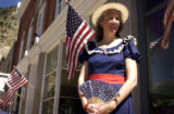 Georgetown resident Julie Jameson (CQ) stands on Main Street on the Fourth of July, where many...