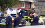A body was discovered in a dumpster  at 25th and Emporia in Aurora on Tuesday July 5,2005. The...
