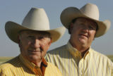 Cheyenne Frontier Days' Arena Director, Tom Hirsig, right, poses for a portrait with his father,...
