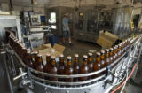 Bottles of Easy Street Wheat roll off the bottling line  at Odell's Brewery in Ft. Collins...