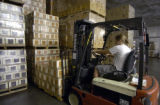 Kelley Herring (cq), warehouse manager, stacks cases of Easy Street Wheat beer in the walk-in...