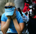 Amateur golfer Morgan Pressel holds her face in her hands after scoring a double-boogie on No. 8...