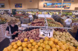 Barbara Abrams (cq), left, of Denver, shops for  nectarines at the Sunflower Market at 2880 S....