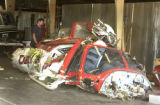 Eddy Schumacher of Beegles Aircraft Service inspects the wreckage of a Tr-State CareFlight...