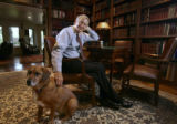 Hank Brown, president and CEO of the Daniels Fund, sits in his home library, with his son's dog,...