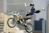 Jim McNeil, 26, of Phoenix, Az. pulls off a 'double grab Indian air' during practice for the...