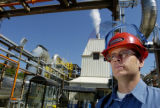 Robert Phelan(cq) stands outside the environmental control system which processes clean air during...