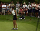 15-year-old golf phenom, Michelle Wie (left) is cheered on by her mother (right top corner) as Wie...