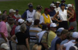 15-year-old golf phenom, Michelle Wie waits to tee off on the 11th hole  on the first day of the...