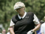 On the 8th hole Laura Davies grimaces after teeing off.  She was cut from the tournament with a 23...