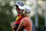 On the 18th hole Nicole Perrot laugh with her caddie Thad Kael after finishing her round.  She is...