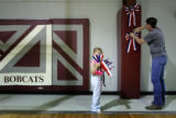Zoe Crouch, left, helps Mike Crafton put up ribbons at the Manzanola High School on Friday, June...