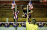 Brothers Mike Mora, above, and Jerry Mora put up ribbons at Manzanola High School on Friday, June...