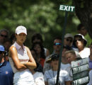 Amateur golfer Michelle Wie, of Honolulu, Hawaii, waits on No. 8 for her playing partner Birdie...