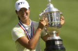 Birdie Kim poses with her trophy after winning the US Open. At Cherry Hills Country Club, the US...