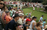The gallery watches Michelle Wie's tee shot on the 1st hole on the final day of competition in the...